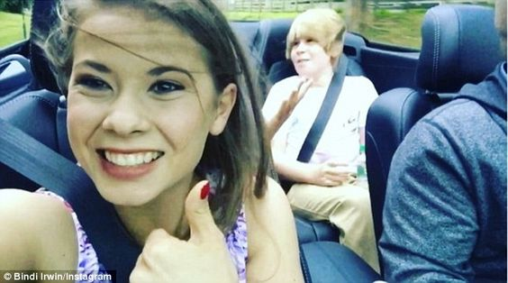 'Adele is always a good idea': Bindi Irwin caught her boyfriend Chandler Powell and little brother Robert in a sing-along to Adele's Hello while they cruised around Hawaii on Sunday