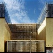 Copper alloy sheeting highlights cubic architecture of the Rhone region's public archives building designed by Gautier & Conquet architects