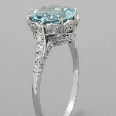 "Antique, Mom had an aquamarine ring very much like this one. Gorgeous ""crown"" style setting."