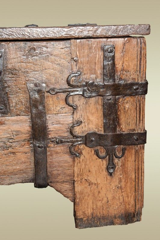 Small Medieval oak ironbound chest, clamp front in construction and the iron work consists of flat straps with fleur-de-lys motifs and a large butterfly lock plate. Origin: Germany Date: Circa 1400 Dimensions: Width (inches) 36 1/2 x Height 21 3/4 x Depth 16