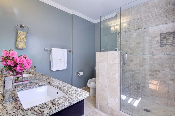 Blue gray neutral bathroom, floor to ceiling tile, cool tones