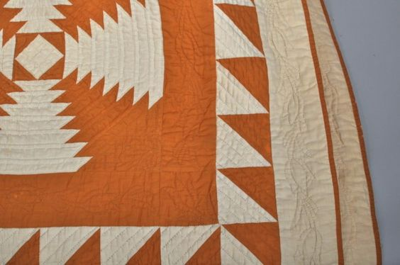 Detail showing quilted tulips: Antique Cheddar & White Log Cabin Pineapple Quilt : Lot 214