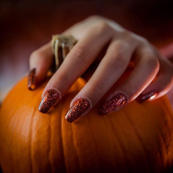 "Fall inspired mani with Revlon's Brilliant Strength ""Captivate."" I drew the leaves by hand using Sally Hansen's I ❤️ Nail Art pen in black (for more details go read the caption on the first picture of this mani). Isn't ""Captivate"" so… well… captivating?!"