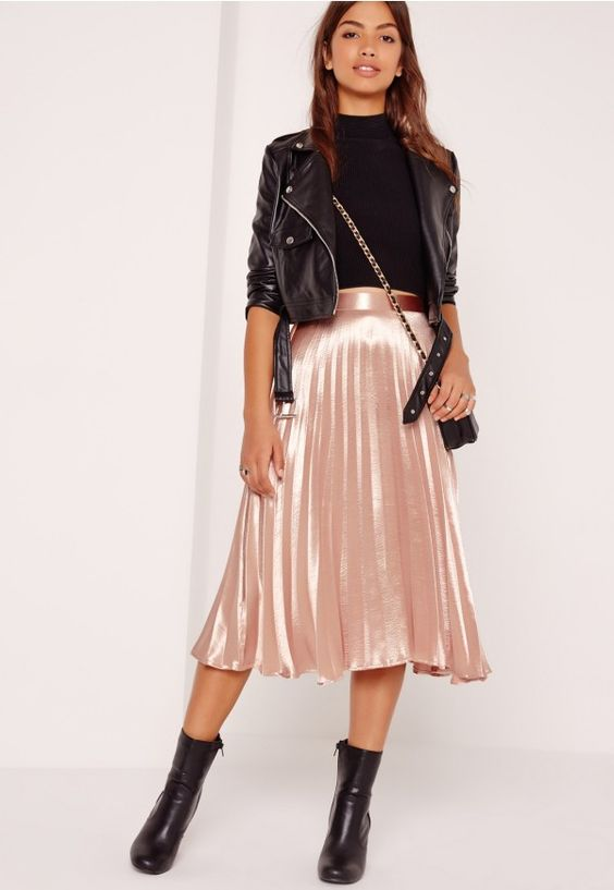 Join the pleat parade in this midi skirt and get set for all eyes on you. Featuring a luxe rose gold hue, midi length and pleated style, this officially passes the twirl test. This 1920's-inspo piece is a total game-changer, so seal these f...