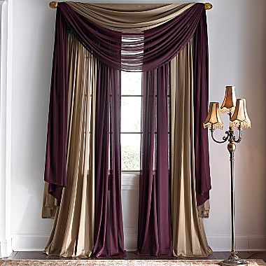 dont love the colors but love the idea of two color curtains for the living room windows: