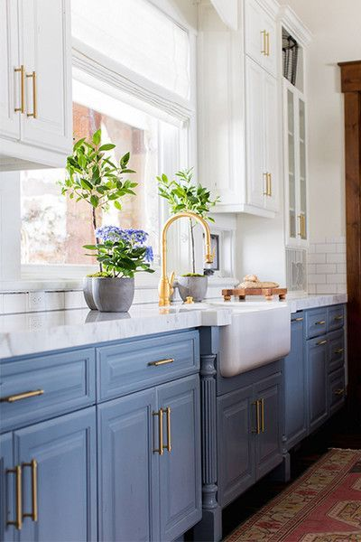Beautiful blue kitchen with gold accents #bluekitchens #bluedecor #kitchendesign #kitchendecor #kitchenremodel #blueandwhitekitchen
