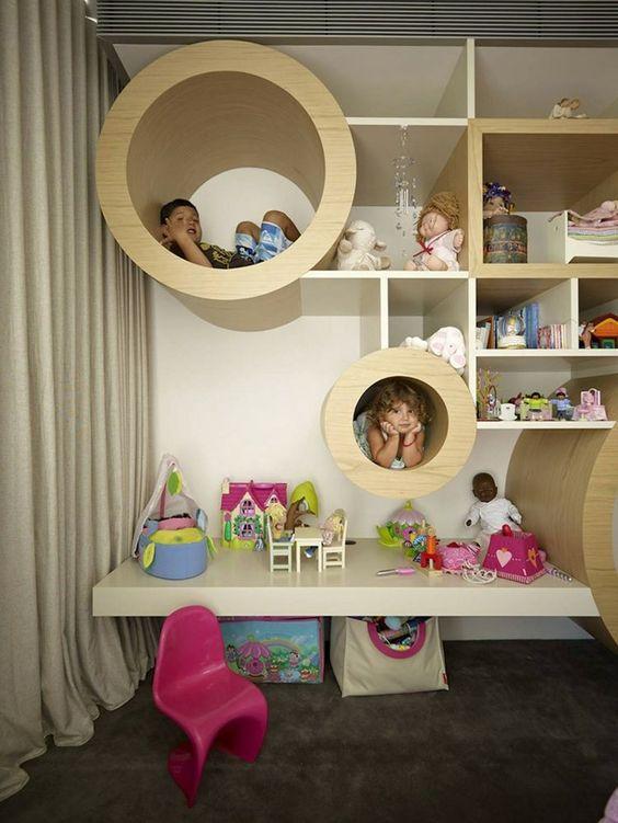Kinderzimmer Design Idee - Das Regal besitzt zylinderförmige Fächer