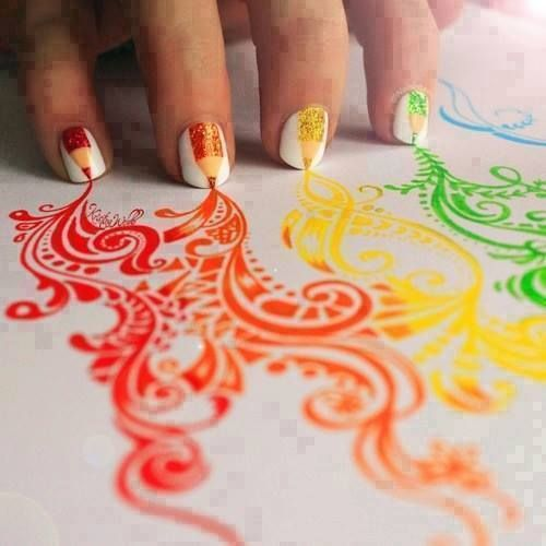 Rainbow nails are drawing.