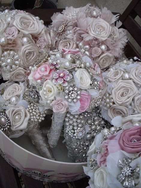 Brooch Bouquets - Love this… so at your wedding shower everyone brings a brooch.  You tell them your colors… beautiful bouquet!