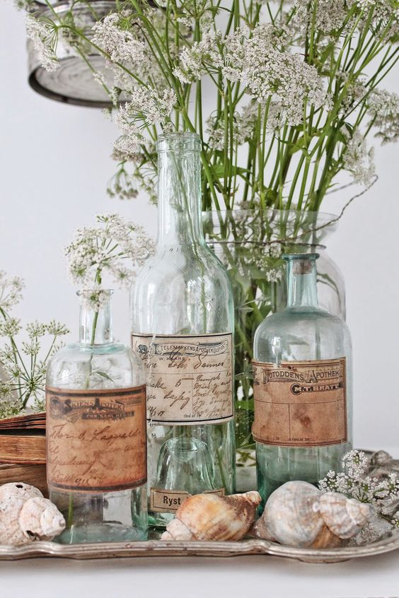 Love the repurposed bottles: amazing what the addition of some vintage labels can do -Vibeke Design-