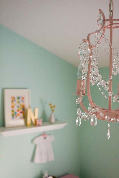 :: Don't be afraid to paint or refinish vintage chandelier hardware to fit you. This one is done in pink for a nursery.