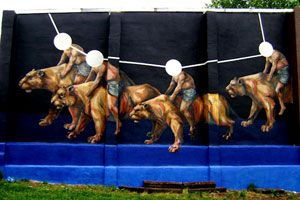 Open Walls Baltimore continues to host local and international artists with spaces to paint murals. Argentinian artist, Jaz, recently completed this piece depicting faceless human bodies riding large cats similar looking to a cougar.