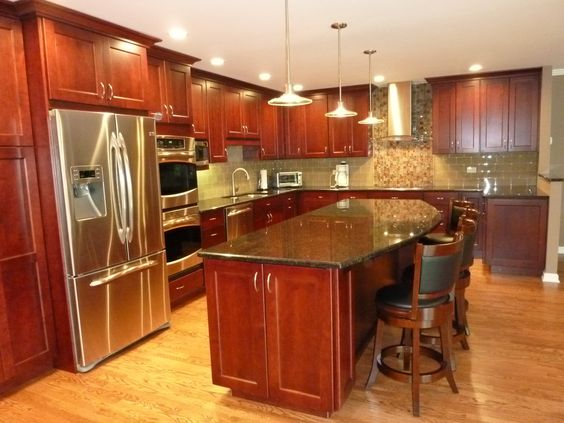 Cherries islands and granite countertops on pinterest for Cherry kitchen cabinets with black granite