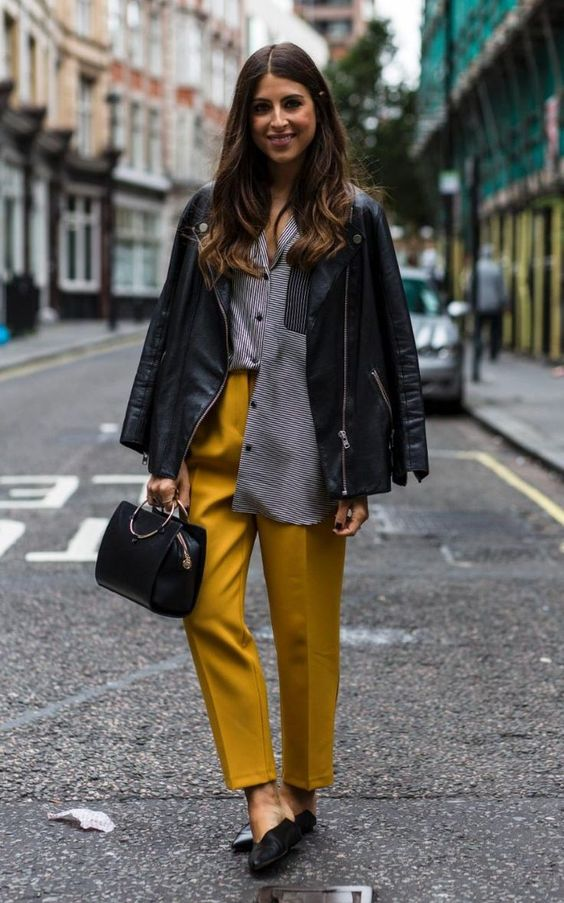 The 'half untucked' shirt trend is still going strong for AW16. Mustard yellow trousers. Leather jacket.