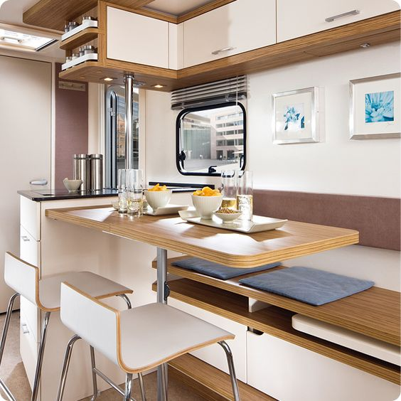 German caravan interior kitchen 39 leben 39 model on the for Caravan kitchen storage ideas