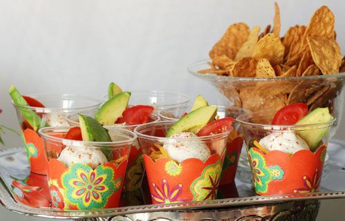 Cupcake wrappers inside plastic cups! Easy decor!