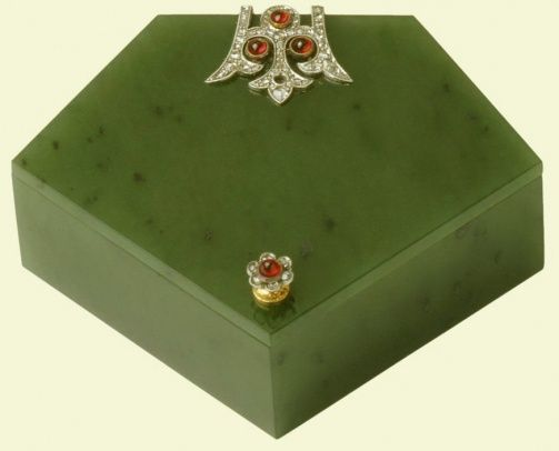 The Royal Collection: Five-sided box,Creator: Fabergé (jeweller) Creation Date: c. 1912. Materials: Nephrite, gold, rose diamonds, cabochon rubies Dimensions: 2.8 x 6.3 x 4.9 cm Acquirer: Queen Mary, consort of George V, King of the United Kingdom (1867-1953) Provenance: Bought by the Dowager Tsarina Marie Feodorovna, 7 December 1912 (275 roubles) by whom given to Queen Mary for Christmas 1912.