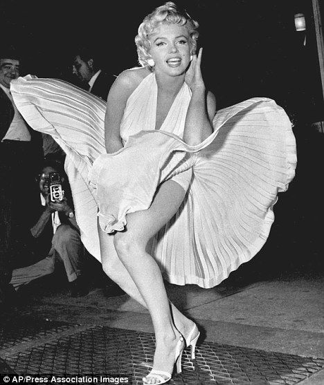 Iconic: Marilyn's skirt blows up as a train passes under the subway grate in 1955.