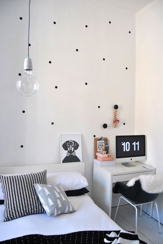 white and black bedroom with office desk.  love the black poka dots on the wall: