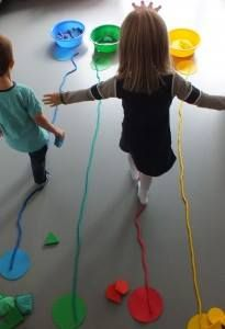Visual motor activity. Child walks on a thin colored string. uses visual and motor abilities.