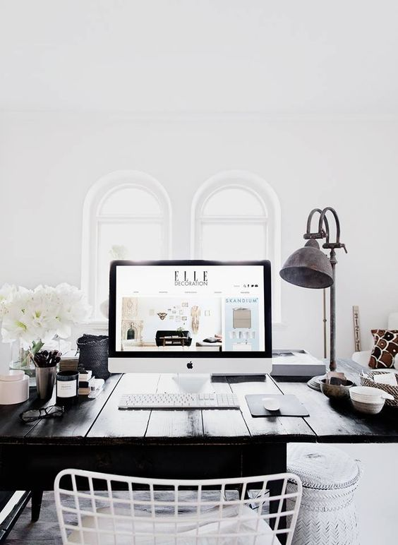 Love the dark desk and vintage lamp