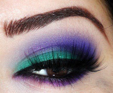 Contrasting eye makeup: green and purple