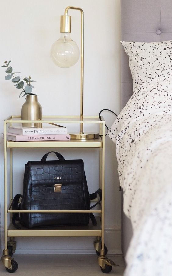 Gold Bar Cart Used As A Bedside Table - Image From Swoon Editions