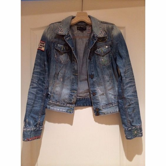 Lucky brand denim jacket Distressed denim with 60's inspired patches and pastel colored embroidery. Nice fit, for a casual look. Worn lightly- in excellent condition. Lucky Brand Jackets & Coats Jean Jackets