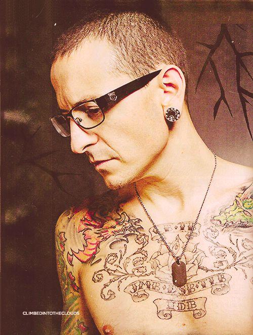 Chester Bennington from Linkin Park. Love tattoos on guys, just not on me..lol
