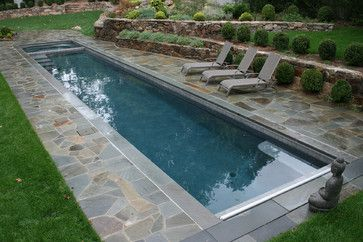 This pool is actually a little large but that's because it's long and narrow. It's great for swimming laps and the stonework on the outside gives it a stylish appearance at the same time.