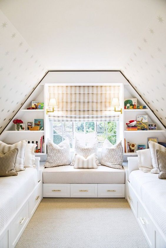 Bright attic bedroom with built-in shelves, and neutral color palettes.: