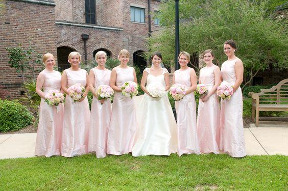 Pale pink bridesmaid dresses.