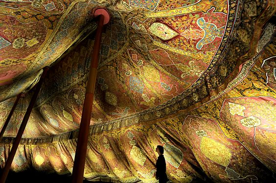 PITCH A TENT: A staff member of the Dresden State Art Collections admired a 17th century Ottoman tent in Dresden, Germany, Monday. (Ralf Hirschberger/DPA/ZUMA Press)