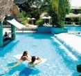 Couples Negril Jamaica pool is one of our favorites, enjoy a drink at the swim up bar!