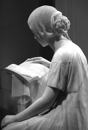 The Reading Girl at the D.C. National Gallery of Art -'The Reading Girl' by Italian sculptor Pietro Magni.  Sculpture shows a fragment of work by the Italian poet and playwright Giovanni Battista Niccolini (1782-1861).