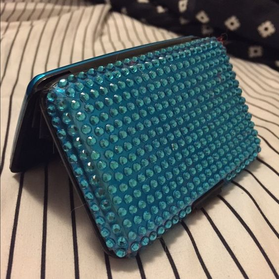 Turquoiseish Gem Credit Card Case This cute wallet has plenty of room for your extra credit cards, debit cards, gift cards, rewards cards, etc! Very simple yet elegant. Beautiful blue color. NWOT. Any questions please ask!  Bags Wallets