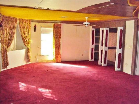 outdated ugly décor red carpet bedroom drapes damaged ceiling Dade City Florida home house for sale photo
