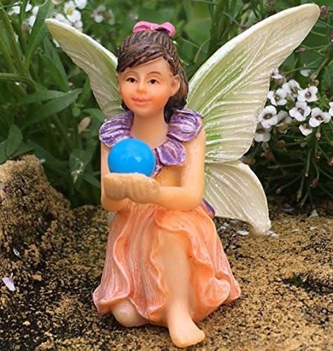 Fairy Crystal sits relaxing in her garden