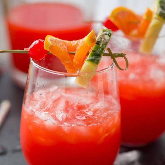 Caribbean Rum Punch with Orange Juice, Pineapple Juice, Lime Juice, Rum, Dark Rum, Grenadine.