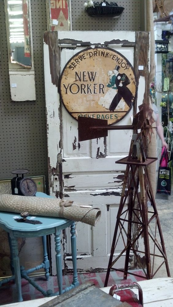 Rusty Windmill, white chippy door & New Yorker sign. Great vintage mix!