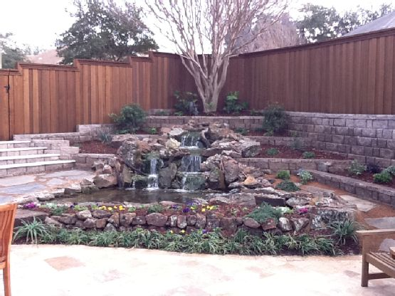 Sloping backyard waterfall with 3 tier retention wall ...