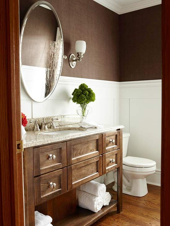 Chocolate color, white wainscoting, vanity, oval mirror