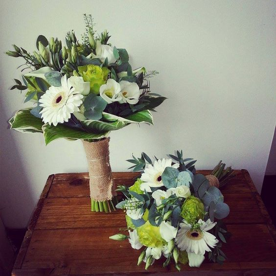 wedding bouquet featuring: green tea rose, lisianthus, germini and calla lily, with a hosta leaf collar, finished with hessian and twine, beautifully rustic.