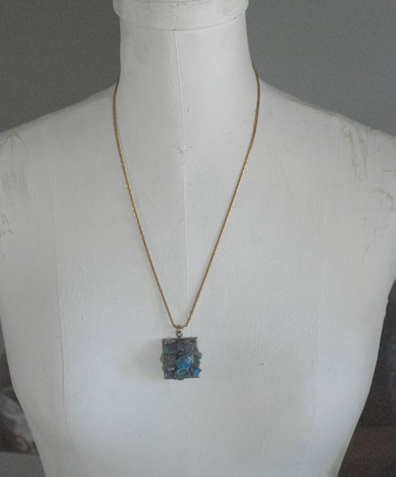 Stunning necklace composed from raw chunks of Peacock Ore. These pretties have been adhered into a Vintaj brass bezel and are suspended from a solid