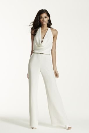 Sophisticated and chic, this elegant crepe sheath halter style jumpsuit ensures you'll be the focus of the day!   Stretch crepe jumpsuit features a flattering peek-a-boo draped halter neckline.  Crystal embellishments adorn the decolletage, waist, and plunging back.  Back zip closure. Imported. Dry clean only. To preserve your wedding dreams, try our Wedding Gown Preservation Kit.
