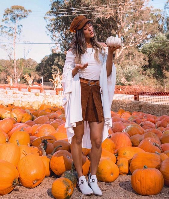 the cutest pumpkin in the patch @jyo_shankar layers our 'love rib off shoulder peplum cuff raglan top' perfectly #chaserbrand
