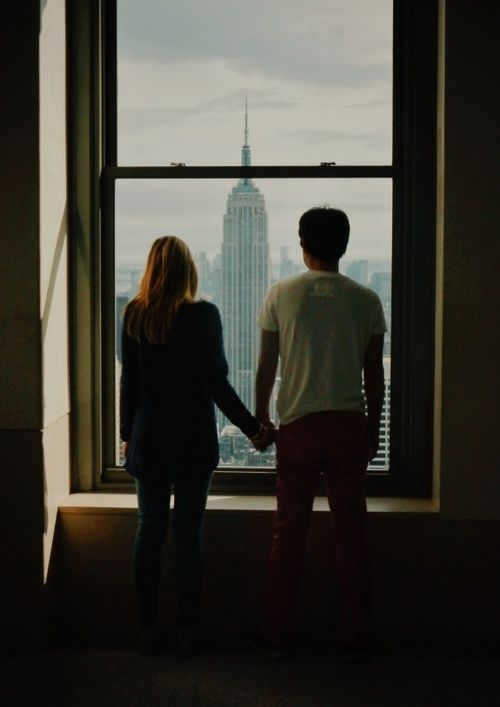 """I told ya I'd take you to New York,"" he said as they looked out the window at the towering Empire State Building. ""And now we're here,"" she whispered. The boy smiled and held her hand. ""And now we're here."""