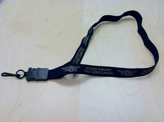 This black, elastic lanyard imprinted with metallic gold ink has a snap away hook. Lanyards are a great for meetings, special events, and daily use to hold badges.