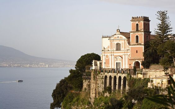 renellated castle, pink-washed clifftop church, and pebbled beach make Vico Equense perhaps the most dramatic—though surprisingly undiscovered—village on the Sorrento Coast.