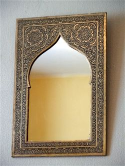 Moroccan mirror in brass coloured frame. The frame has a traditional 'embossed' design.  Approx Height: 41 cm Width: 21cm